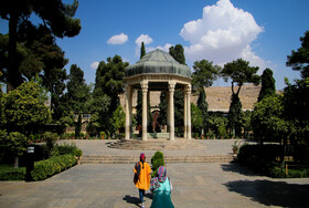 The Tomb of Hafez is seen in the photo, Shiraz, Iran, October 14, 2019. Located in Shiraz, The Tomb is the resting place of the well-known Iranian poet, Hafez. Hafez's tomb lies in the Musalla Gardens, inside an open pavilion encircled by eight columns, topped with a mosaic-tiled dome that glows beautifully when lit at night.