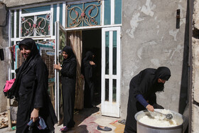 Women prepare food for the pilgrims of Imam Hussain (PBUH) during Arbaeen March, Iraq, October 18, 2019.
