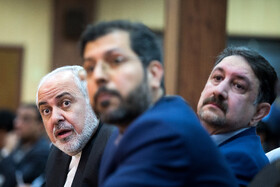 "Iranian Foreign Minister Mohammad Javad Zarif (L) is seen during the international conference on ""Unilateralism and International Law"", Tehran, Iran, October 21, 2019.
