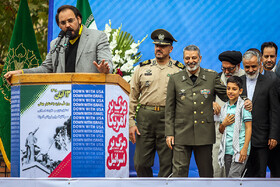 Commander of Iran's Army Major General Seyyed Abdorahim Mousavi (2nd, L) is present in the rallies of people of Tehran to mark the 40th occupation anniversary of the former US embassy in Tehran, Iran, November 4, 2019.