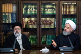 Iranian President Hassan Rouhani (R) and Iran's Judiciary Chief Ebrahim Raeisi are present in the meeting of Iran's Supreme Council of Cultural Revolution, Tehran, Iran, November 19, 2019.
