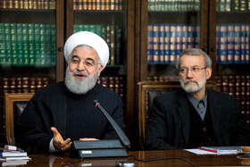 Iranian President Hassan Rouhani (L) and Iranian Parliament Speaker Ali Larijani are present in the meeting of Iran's Supreme Council of Cultural Revolution, Tehran, Iran, November 19, 2019.