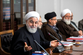 Iranian President Hassan Rouhani (L) is present in the meeting of Iran's Supreme Council of Cultural Revolution, Tehran, Iran, November 19, 2019.