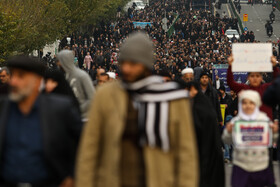 People of Tehran stage a rally to avow support for the country's Islamic establishment, condemn the recent violent rioting that broke out after fuel price rise and convey their demands to the authorities, Tehran, Iran, November 25, 2019.