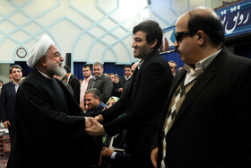 Iranian President Hassan Rouhani (L) is present in a ceremony held to mark the International Day of Persons with Disabilities, Tehran, Iran, December 3, 2019.