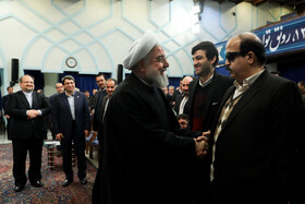 Iranian President Hassan Rouhani (front, L) is present in a ceremony held to mark the International Day of Persons with Disabilities, Tehran, Iran, December 3, 2019.