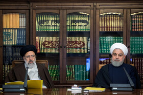 Iranian President Hassan Rouhani (L) and Iran's Judiciary Chief Ebrahim Raeisi are present in the meeting of the Supreme Council of Cyberspace, Tehran, Iran, December 14, 2019.