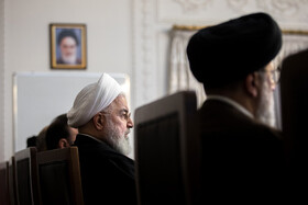 Iranian President Hassan Rouhani (L) is present in the meeting of the Supreme Council of Cyberspace, Tehran, Iran, December 14, 2019.