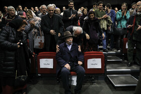 Veteran Iranian actor Ali Nasirian (front) is seen during a ceremony in which his 85th birthday is celebrated, Tehran, Iran, February 8, 2020.