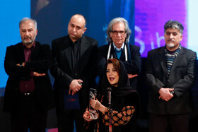 "Actress Tannaz Tabatabaei wins Best Supporting Actress Crystal Simorgh for ""Butterfly Swimming"" during the closing ceremony of the 38th Fajr Film Festival, Tehran, Iran, February 11, 2020."