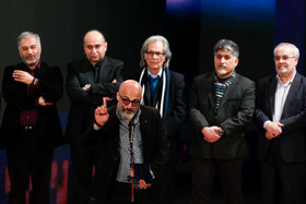 "Actor Amir Aghaei (front) wins Best Supporting Actor Crystal Simorgh for ""Butterfly Swimming"" during the closing ceremony of the 38th Fajr Film Festival, Tehran, Iran, February 11, 2020."
