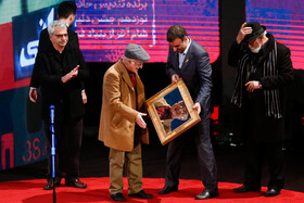 Film director Fereidoun Jeyrani (front) is honored during the closing ceremony of the 38th Fajr Film Festival, Tehran, Iran, February 11, 2020.