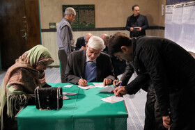 Iranian politician Mohammad Reza Aref (M) casts his vote in the 11th parliamentary and Assembly of Experts elections, Tehran, Iran, February 21, 2020.
