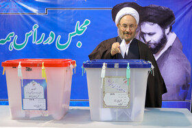Iranian politician Ali Younesi casts his vote in the 11th parliamentary and Assembly of Experts elections, Tehran, Iran, February 21, 2020.