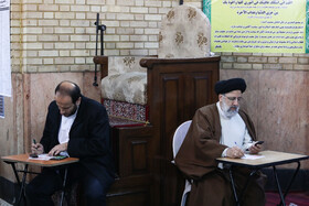 Iran's Judiciary Chief Ebrahim Raeisi (R) casts his vote in the 11th parliamentary and Assembly of Experts elections, Tehran, Iran, February 21, 2020.
