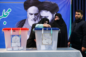 Iranian politician Zahra Mostafavi casts his vote in the 11th parliamentary and Assembly of Experts elections, Tehran, Iran, February 21, 2020.
