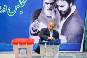 Head of Iran's Plan and Budget Organization (PBO) Mohammad Bagher Nobakht casts his vote in the 11th parliamentary and Assembly of Experts elections, Qom, Iran, February 21, 2020.