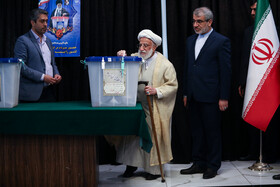 Secretary of Guardian Council Ayatollah Ahmad Jannati casts his vote in the 11th parliamentary and Assembly of Experts elections, Tehran, Iran, February 21, 2020.