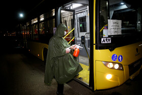 Buses are disinfected in order to curb the spread of the new coronavirus in Qom, Iran, February 22, 2020.