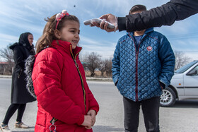People are checked in order to detect those who have a temperature, Urmia, Iran, March 5, 2020.