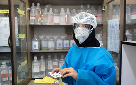 """Ms. Boka, the nurse of Kamkar Hospital, is seen in the photo, Qom, Iran, March 12, 2020. When asked about the current situation in fighting the coronavirus, she said, """"Being at the hospital in these days is a duty and the support from our families has made the job easier for us""""."""
