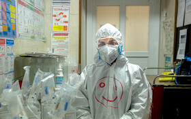 """Ms. Majani, the staff of Kamkar Hospital, is seen in the photo, Qom, Iran, March 12, 2020. When asked about the current situation in fighting the coronavirus, she said, """"Despite the shortage of equipment, all my colleagues continue their work with a lot of energy to control the situation""""."""