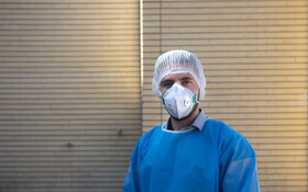 """Mahmoud Ahmadi, the staff of Kamkar Hospital, is seen in the photo, Qom, Iran, March 12, 2020. When asked about the current situation in fighting the coronavirus, he said, """"Since the hospital has been chosen for treating coronavirus cases, we work in long shifts""""."""