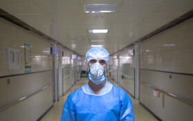 """Mr Rasouli, the staff of Kamkar Hospital, is seen in the photo, Qom, Iran, March 12, 2020. When asked about the current situation in fighting the coronavirus, he said, """"I joined other nurses in different wards of the hospital to help them in the fight against the coronavirus""""."""