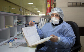 """Ms. Ghorbani, the nurse of Kamkar Hospital, is seen in the photo, Qom, Iran, March 12, 2020. When asked about the current situation in fighting the coronavirus, she said, """"I have been working as a nurse for 28 years and all patients are the members of my family""""."""