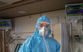 """Ms. Ghazaghi, the nurse of Kamkar Hospital, is seen in the photo, Qom, Iran, March 12, 2020. When asked about the current situation in fighting the coronavirus, she said, """"I work in a place which everybody is afraid of, but my colleagues and I continue our work devotedly""""."""