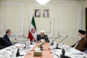 "Iranian President Hassan Rouhani (M), Iranian Parliament Speaker Ali Larijani (L) and Iran's Judiciary Chief Ebrahim Raeisi are present in the session of ""National Headquarters for Fighting Coronavirus"", Tehran, Iran, March 19, 2020."