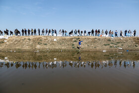 People of Aq Qala try to prevent the flood from inundating their city, Golestan, March 24, 2019.