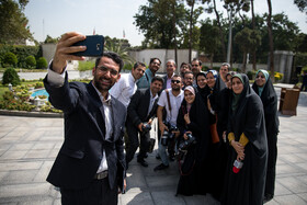 Iran's Minister of Information and Communications Technology Mohammad Javad Azari Jahromi takes a selfie with correspondents, Tehran, Iran, August 7, 2019.