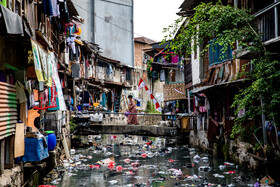 The Story of Streets in Jakarta, Indonesia, November 6, 2019. It is estimated that 95 percent of northern Jakarta will be submerged until 2050 so that the government of Indonesia is planning to transfer the capital from Jakarta to Borneo Island at a cost of 33 billion dollars.