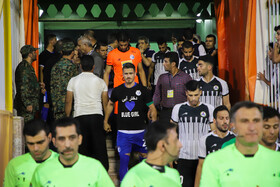"""Football player of Esteghlal FC Voria Ghafouri, wearing black T-shirt with the name of """"Blue Girl"""" on it, is seen on the sidelines of a football match. Dubbed """"Blue Girl"""" because of Esteghlal's colour, she was a fan of Esteghlal FC who set herself on fire a few days before this football match."""