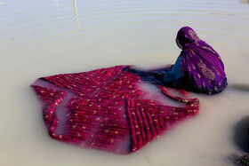 A woman is seen in the photo after a heavy flood inundates Sistan-Baluchestan Province, Iran, January 14, 2020.
