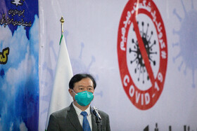 Chinese ambassador to Tehran, Chang Hua, is present during the ceremony in which Iran receives China's humanitarian aid for fighting against the new coronavirus, Tehran, Iran, March 25, 2020.