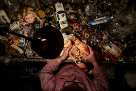 Sabah Khaleghi repairs a toy, Iran, April 12, 2020.