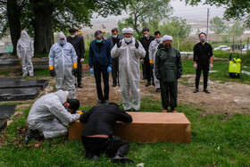 The burial ceremony of a coronavirus case, Mazandaran, Iran, May 3, 2020.