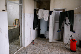 The clothes of the body washers are seen in the photo, Mazandaran, Iran, May 3, 2020.