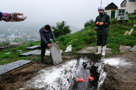 The burial ceremony for a coronavirus case, Mazandaran, Iran, May 3, 2020.