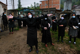People are seen in the photo during a mourning ceremony, Mazandaran, Iran, May 3, 2020.