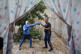 Maede Hashemi, the sanda competitor of Iran's national wushu team, keeps fit by training at home, Iran, May 9, 2020. During the outbreak of the new coronavirus, all sports activities and competitions have been canceled, but athletes keep fit by training at home.