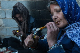"Two drug addicts are seen in a neighborhood called ""Sang-e Siah"", Shiraz, Iran, June 25, 2020."
