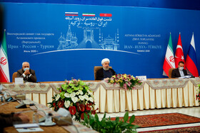 Iranian President Hassan Rouhani (M) and Iranian Foreign Minister Mohammad Javad Zarif (L) are seen during a virtual conference with Russian President Vladimir Putin and Turkish President Recep Tayyip Erdoğan, Tehran, Iran, July 1, 2020.