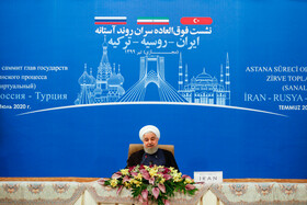 Iranian President Hassan Rouhani is seen during a virtual conference with Russian President Vladimir Putin and Turkish President Recep Tayyip Erdoğan, Tehran, Iran, July 1, 2020.