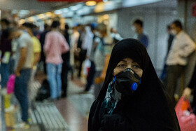 People are seen at a Metro station after wearing face masks becomes compulsory, Tehran, Iran, July 6, 2020.