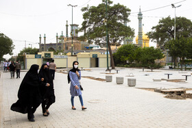 People are seen while wearing face masks have become compulsory, Qom, Iran, July 13, 2020.