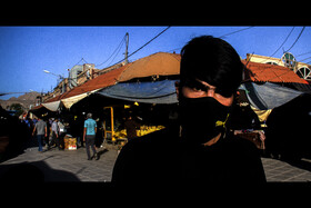 A man wearing a face mask is seen in a bazaar of Kerman, Iran, July 26, 2020. New coronavirus cases have increased in Kerman Province in recent days.