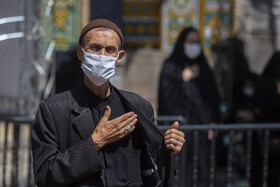 A man attends a mourning ceremony on Ta'sua Day of Muharram Month at the Holy Shrine of Hazrat-e Masoumeh, Qom, Iran, August 29, 2020.